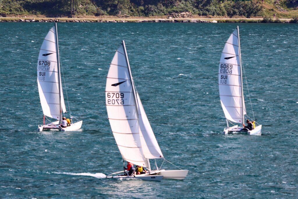 Sailing together in Switzerland on Dart 18 Catamrans